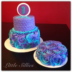 1st birthday cake and smash cake. Purple and teal blue buttercream quilted and with rosettes.