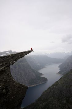 I want to sit on Trolltunga in Norway Because nature is awesome.