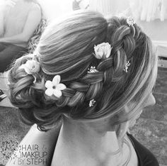 Braided with flowers.