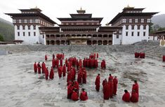 """Buddhist monks stand inside the complex of Tashichhodzong, also known as the """"The Fortress of the Glorious Religion"""" in Bhutan's capital. The Tashichhodzong was built by Shabdrung Ngawang Namgyal in 1641 (April — in Thimphu, Bhutan. Bhutan, Best Places To Travel, Oh The Places You'll Go, Mandalay Hotel, The Forbidden Kingdom, World Thinking Day, Asian History, Green Landscape, Holiday Destinations"""