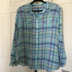 Plaid button down blouse Plaid button down blouse. With 2 pockets. Rollable sleeves with buttons to keep them in place. Thin material. The only flaw but is a easy fix.... There is a button missing. Old Navy Tops Button Down Shirts