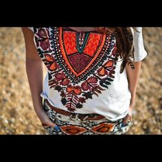 Tribal Graphic Tee Not my picture but in very good condition! High-low tee, so a little longer in the back. Very comfy Urban Outfitters Tops Tees - Short Sleeve