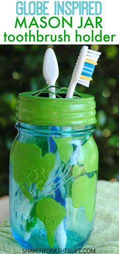 As a gentle Earth Day reminder to be mindful of bathroom habits like turning off lights and water, make a cool Globe Inspired Mason Jar Toothbrush Holder! #masonjar #EarthDay
