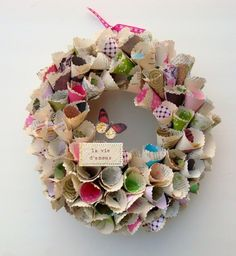 Vintage inspired paper wreath - this would be cute with the book pages and leftover scrap booking paper!