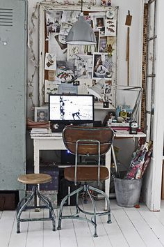 Small vertical office space built with vintage pieces. I like the storage locker on the left.