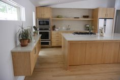 Custom maple kitchen cabinets with light colored quartz counter tops.