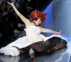 models falling on the runway
