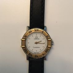 Omega guaranteed authentic Constellation watch Beautiful classic Omega watch purchased in 1993.  New battery and black leather band.  In very good condition and working order.  No noticeable scratches or dings although there is slight visible wear on the Roman numeral V. I will include the original purchase receipt. Omega Jewelry