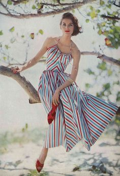 May Vogue 1957... She is beautiful...This would have been so pretty to wear on the 4th of July