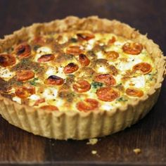 Cheese and tomato quiche with visible tomatoes showing in the quiche.