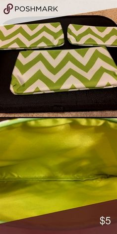 3 Piece Cosmetic Bag Set New three piece chevron green cosmetics bag set. Zipper is gold hardware, Can store any items.