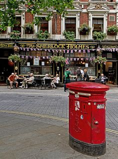 The Sherlock Holmes Pub - Westminster, Charing Cross, London  I love the red post boxes.  I even know where this one is.  One of the few places I know how to find.