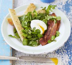 Crispy bacon and a perfectly cooked egg with oozing yellow yolk is a brunch staple - this version teams it with watercress
