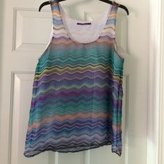 Patterned tank Lightweight wavy striped tank top. Super cute print on this one! Size says small but fits more like a medium. (From Nordstrom Rack) Casual Freedom Tops Tank Tops