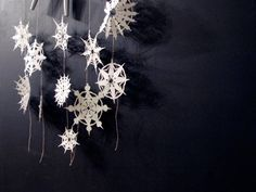 Make paper snowflakes!  There are so many sources online that teach you how to make these (check out Martha Stewart's simple DIY steps here for a good starting point), or you can just wing it and see how they turn out - you never know!  Connect them with string to make a garland or hang them like this on the back of your door or over a window.