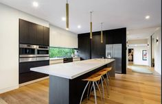 Kitchen Design with Black Wenge Cabinetry and Concrete Caesarstone Bench top
