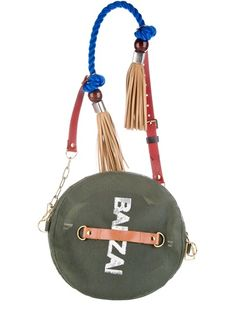 Green Disc bag from Banzai featuring a blue twisted cord and brown faux-leather shoulder strap, faux-leather tassels and gold-tone chain detailing, a green bag section with a white printed Banzai logo.