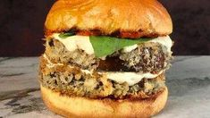 Michael Symon's Fried Eggplant Sandwiches with Harissa Chili Burgers Recipe, Burger Recipes, Vegetable Dishes, Vegetable Recipes, Vegetarian Recipes, Delicious Recipes, Tasty, Yummy Food, Sandwiches For Lunch