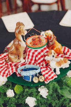Lady and the Tramp table decor - The bride and groom made amazing Disney-themed centerpieces out of their childhood toys