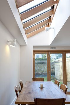 Perfect roof lights. Like the use of wood very much. Where the wall sinks in I would have floor to ceiling shelves flush with the bit of wall that sticks out