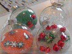 DIY Christmas Ornaments your kids can fill. They are too heavy for the tree but makes a beautiful centerpiece on a table or kitchen island. I did this with my 4 and almost 2 year old and they had a blast! I put them in a trifle bowl and added some decorations to the bottom of the glass just to give it a little something extra.