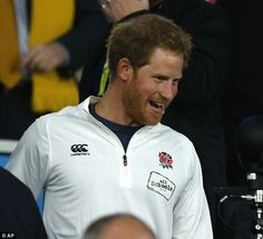 Prince Harry smiles as he arrives for the Rugby World Cup Pool A match between England and Australia at Twickenham