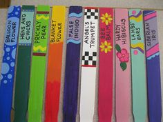 Plant markers made from paint stir sticks.