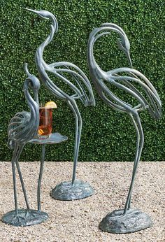 Modern art interpretations of one of nature's most impressive creatures, our Stylized Heron sculptures beautifully capture the elegance of these unique birds. Crafted from aluminum with a beautiful verdigris finish, these stunning sculptures make a perfect pair, whether indoors or outside.