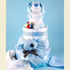 The sizes of our diaper cakes range from little petite cakes to gigantic, 4 or 5 tiered masterpieces that are sure to garner lots of attention at the party.  The most difficult part is to bring oneself to dismantle this treasure to get to the diapers and baby toys and to then use them for the baby!