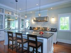 Pendant lighting, stainless steel, and a great backsplash -- a true 21st century kitchen! #DigIt #interiordesign