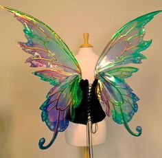 These are large fairy wings made with a very lightweight cut aluminum sheet and a laminated iridescent film that reflects a rainbow of colors.