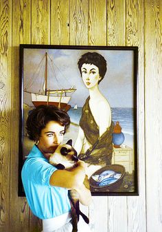 Elizabeth Taylor | You see? not as sensitive to the holding and bonding with a cat as she should be.