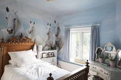 A girl's passion for horses is reflected in the wallpaper in her bedroom featuring a herd of grays. Fairy lights and a princess dressing table keep things suitably girly.