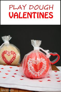 These play dough Valentines make great Valentine non-candy treats for preschool and kindergartner classroom party. Fun Valentine's Day activity for kids. Use heart shaped cookie cutter and decorate with beads | at Non-Toy Gifts