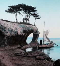 A BOATMAN HOISTS HIS SAIL ALONG THE SCULPTED SHORES OF MATSUSHIMA in OLD JAPAN. A circa 1900 composition photographed by K. TAMAMURA of Yokohama, Japan. From a hand-colored glass lantern-slide. Text and image via Okinawa Soba on Flickr The Kimono Gallery
