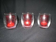 Red Assorted Tealight Holder by Holiday Living. $7.00. Clear Candle holder with a second one inside that is Red. Three different Designs (Christmas Tree, Stars, Snowflakes). Comes with 3 tealight Candles. The outside candle holder is clear. The inside candle holder is red with each candle holder has a different design. One has Christmas Trees, the second one has Stars and the third one has Snowflakes.