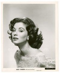 Image from http://www.emovieposter.com/images/moviestars/AA110818/200alt/8x10_suzy_parker_JC01105_L.jpg.