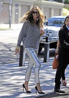 Elle Macphereson in one of the best outfits I've ever seen (Balmain pants, Louboutin studded Pigalle shoes).