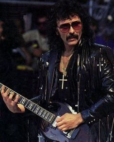 TONY IOMMI OF BLACK SABBATH IN EARLY DAYS WITH HIS GIBSON SG CUSTOM GUITAR  HEAVY METAL T-SHIRTS and METALHEAD COMMUNITY BLOG. The World's No:1 Online Heavy Metal T-Shirt Store & Metal Music Blog. Check out our Metalhead Clothing and Apparel Store, Satanic Fashion and Black Metal T-Shirt Stores; https://heavymetaltshirts.net/