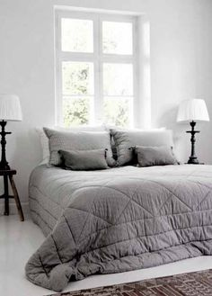 Gray and white bedroom.  #grayandwhitebedroom #minimalisticbedroom #brightbedroom