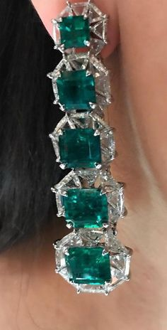Absolutely love these stunning emerald and diamond earrings by @karensuenfinejewellery. This green waterfall with majestic emeralds, each placed gracefully in a bed of diamonds, was created to resemble the French Riviera . Such elegance! . #karensuen #karensuenfinejewellery #emerald #diamond #earrings #bespokejewels