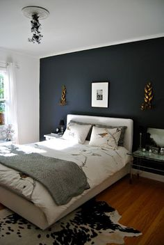 i love dark walls behind the headboard