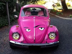 Pink VW with eyes on hood