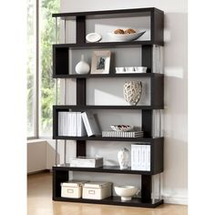 Showcase your books and decorations on this display shelving unit. The zigzag orientation of the six shelves offers a compelling visual appearance.