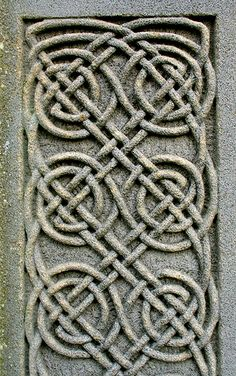 Carved Panel from the great Celtic Cross of Lindisfarne Abbey, Northumberland. The patterns are copied from the illuminated books created by the monks of Lindisfarne Abbey. An inscription added to the panels honours God and St. Cuthbert by Eadfrith, Bishop of Lindisfarne in 721.