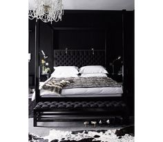 Jet-black in your bedroom is cool and calming and will ensure that drifting off is a cinch. And thanks to its rock 'n' roll leanings, it makes typically traditional accents like chandeliers and hide rugs come off as more fashion-forward than formal.