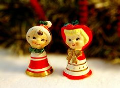 These are so cute!! Vintage collectible Christmas bell ornaments in the shape of kids boy/girl from the 1950s by Lefton. The girl has blonde hair and a gold bow on her neck with a red hat with green holly in it. The boy has a stocking hat with green holly and a green bowtie. Both have cute faces and big eyes with long lashes. They measure approx. 3 1/4 tall and are 1 7/8 wide on their bottoms. They are in very good vintage condition with NO chips, NO cracks, minimal wear, paint...