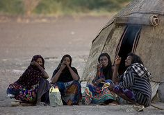 https://flic.kr/p/52fDpJ | Afar Tribe Family, Assaita, Afar Regional State, Ethiopia | Traditional camp. Women are not supposed to talk or meet stangers before men do. danakil desert, Ethiopia, Afar triangle.  © Eric Lafforgue  www.ericlafforgue.com
