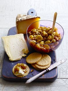 Sweet Roasted Grapes with walnuts... served with cheese on crackers! Yum!