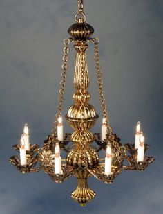 Metropolitan in Gold:  A graceful majestic chandelier that will give a refined and grand look to any room or entrance hall. Its circular design spreads light with a warm glow. Also pictured below in Antique Bronze.  It has 8 candlelights.  3 5/8 inches in length 2 5/8 inches in diameter